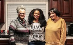 """Evie Allen (center) poses for a photograph with her mother, Clarissa Allen (left), and her aunt, Anita Csaszar (right), Feb. 13, 2021, in Marion, Ill. The three women discussed how, no matter what hairstyle or texture someone has, it should be accepted and embraced because it is not for any one person to dictate what hairstyles are right or wrong. """"Whatever I do to my hair, it's me that I've got to please, even though we've spent so much time trying to please somebody else,"""" Clarissa Allen said."""