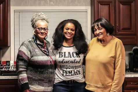 "Evie Allen (center) poses for a photograph with her mother, Clarissa Allen (left), and her aunt, Anita Csaszar (right), Feb. 13, 2021, in Marion, Ill. The three women discussed how, no matter what hairstyle or texture someone has, it should be accepted and embraced because it is not for any one person to dictate what hairstyles are right or wrong. ""Whatever I do to my hair, it's me that I've got to please, even though we've spent so much time trying to please somebody else,"" Clarissa Allen said."