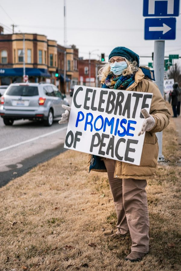 Georgeann Hartzog holds a sign at the Southern Illinois Peace Coalition's Monthly Peace and Justice Vigil Saturday, Feb. 5, 2021, at the corner of W. Main St. and Illinois Ave. in Carbondale, Ill. This month, the group chose to host the vigil on the U.S. involvement in the war on Yemen.