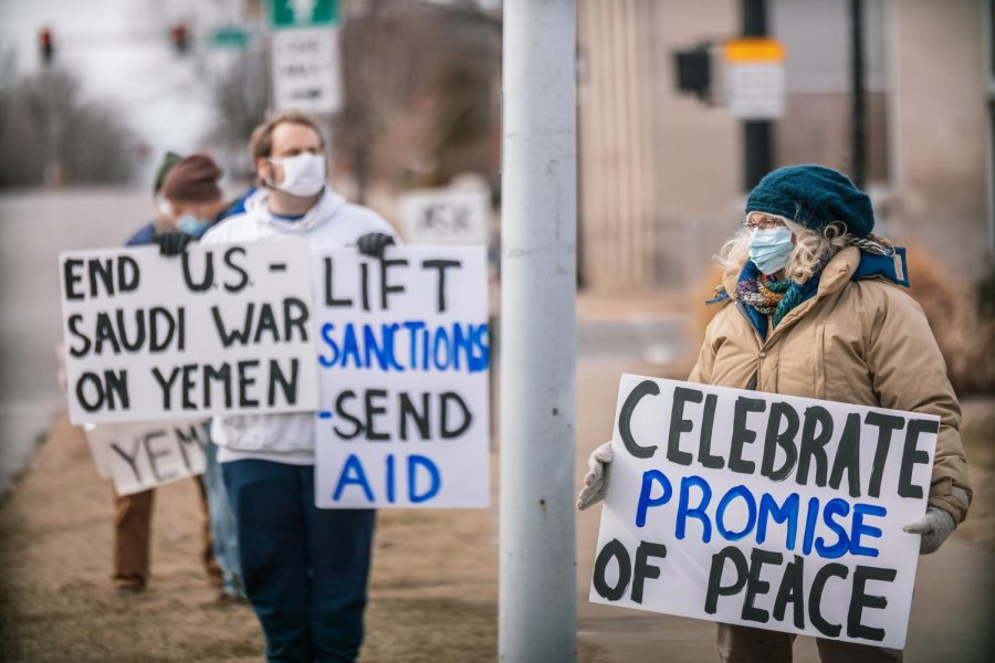 Protestors hold signs at the Southern Illinois Peace Coalitions Monthly Peace and Justice Vigil Saturday, Feb. 5, 2021, at the corner of W. Main St. and Illinois Ave. in Carbondale, Ill. Due to Bidens announcement to end the U.S. support of the Saudi war in Yemen on Feb. 4, the Peace Coalition decided to dedicate their vigil this month to supporting the end of the war in Yemen.