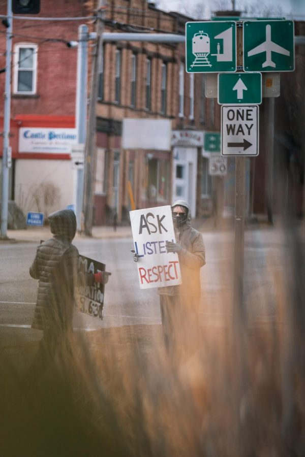 A protestor holds a sign at the Southern Illinois Peace Coalition's Monthly Peace and Justice Vigil Saturday, Feb. 5, 2021, at the corner of W. Main St. and Illinois Ave. in Carbondale, Ill. Due to Biden's announcement to end the U.S. support of the Saudi war in Yemen on Feb. 4, the Peace Coalition decided to dedicate their vigil this month to supporting the end of the war in Yemen.