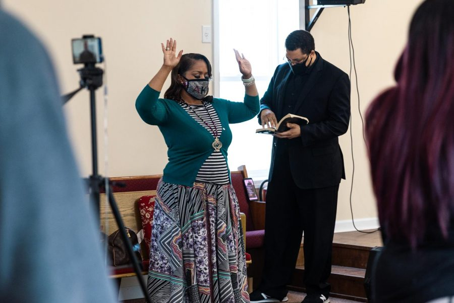 Neophansya Robinson, First Lady of Zion Temple COGIC, holds up her hands during worship Sunday, Feb. 8, 2021, at Zion Temple COGIC church in Murphysboro, Ill.