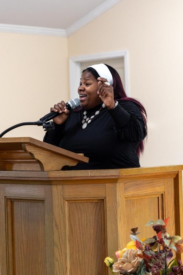 Danielle Pollard leads worship on Sunday, Feb. 8, 2021, at Zion Temple COGIC church in Murphysboro, Ill. According to Neophansya Robinson, the women who sing on the praise team sing every Sunday and have not missed  one Sunday during the pandemic.