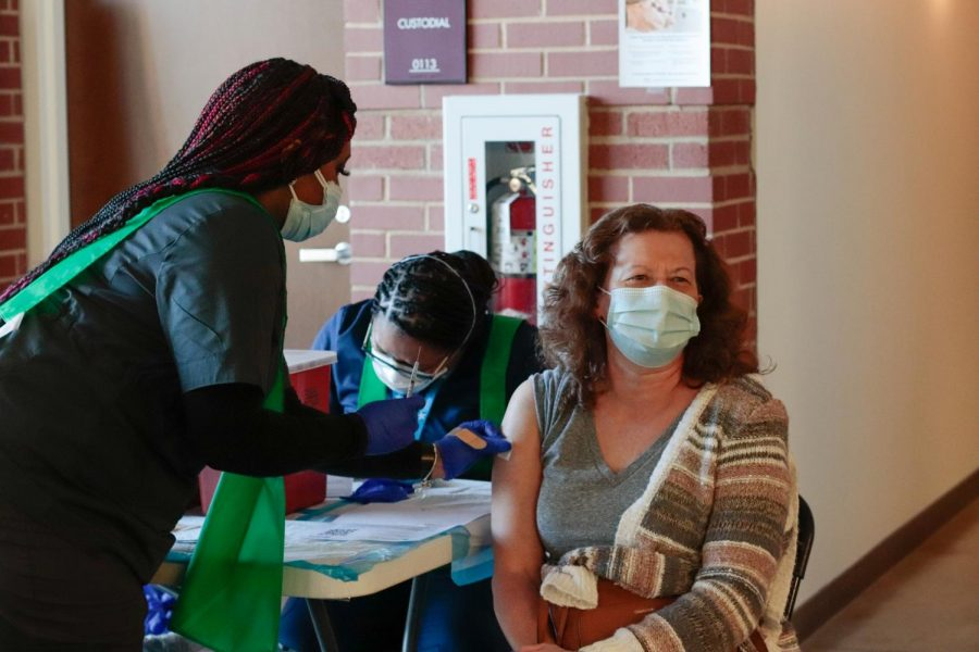 """Sara Ranchino receives her first vaccination Feb. 20, 2021 at the Banterra Center in Carbondale Ill. """"What it means to me I guess mostly is trying to get our lives back to normal or the way it used to be,"""" Ranchino said."""