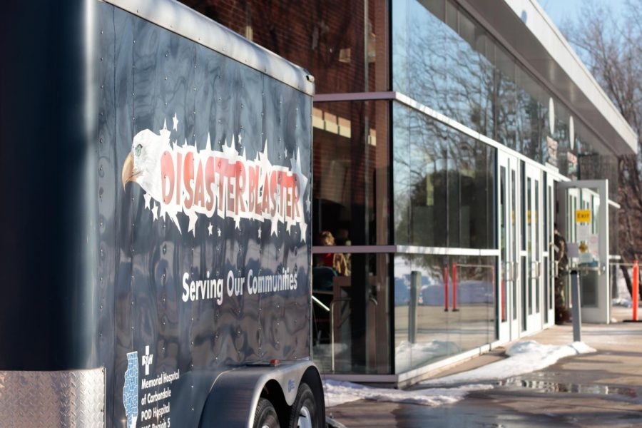 A trailer with the words Disaster Blaster sits outside the Banterra Center at SIU Feb. 20, 2021. The clinic was vaccinating community members who were eligible for the vaccine.
