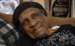 "Dorothy Carter sits for portrait on Feb. 12 at her home in Marion, Ill. Born Jan. 25, 1918, Carter celebrated her 103rd birthday. She has lived in southern Illinois most of her life and has seen the area's attitude towards race change during her time. ""It's much better now. We're all mixed together now,"" Carter said. ""From thinking way back when we wasn't allowed to associate together, now we are all friends together. We are all socialized together, we go to school together, it's much different than it used to be years ago. It's a pleasure to know that we all can get along in this world together. It's more fun now than it used to be."""