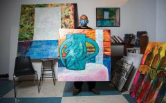 "SIU professor, Najjar Abdul-Musawwir, displays a painting of his of a vase in his studio at the Glove Factory on Friday, Feb. 13, 2021 in Carbondale, Ill. As a young adult, Abdul-Musawwir dropped out of high school and was later imprisoned after an armed robbery attempt. While in prison, he had a change of heart after meeting a nearby inmate who encouraged him to self-educate himself ""I ended up not being in school and when I got in prison, he [a fellow inmate] made me realize that I couldn't read...as a result, I read everything I could get my hands on. I read the dictionary several times from front to back,"