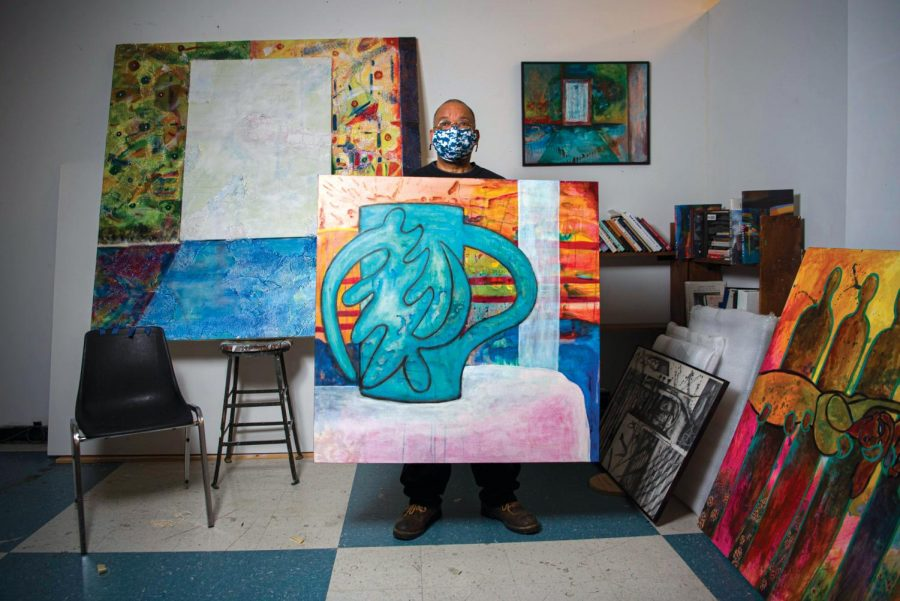 """SIU professor, Najjar Abdul-Musawwir, displays a painting of his of a vase in his studio at the Glove Factory on Friday, Feb. 13, 2021 in Carbondale, Ill. As a young adult, Abdul-Musawwir dropped out of high school and was later imprisoned after an armed robbery attempt. While in prison, he had a change of heart after meeting a nearby inmate who encouraged him to self-educate himself """"I ended up not being in school and when I got in prison, he [a fellow inmate] made me realize that I couldn't read...as a result, I read everything I could get my hands on. I read the dictionary several times from front to back,"""