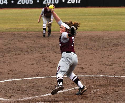 Madi Eberle (3) pitches in the game against Ball State University on Saturday, Feb. 27, 2021 at Charlotte Softball Stadium in Carbondale, Ill. Eberle later scored the run of the season against Ball state University. SIU went on to win against Ball State with the score of 6-1.