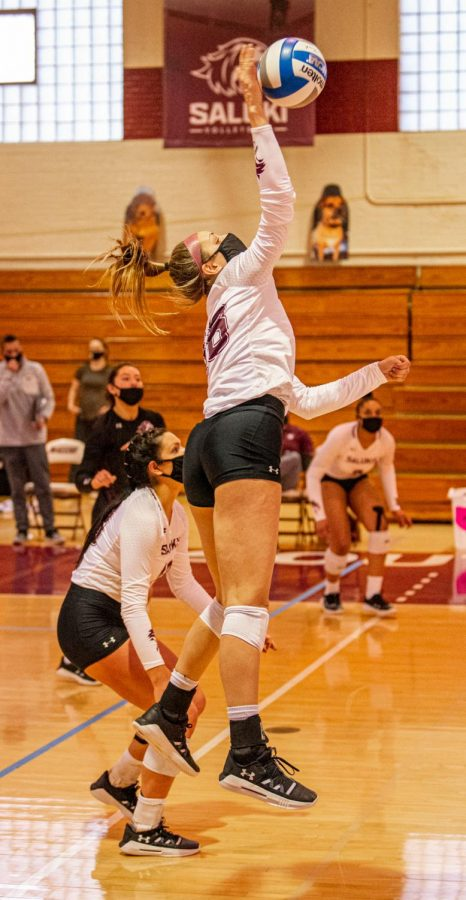 Emma Baalman goes up for the spike during the game verse Indiana State on Sunday, March 7, 2021 in Davies Gym at SIU. The Salukis' would go on to lose 3-0 to the Sycamores. Baalman finished the game with six kills and lead the team with four blocks.