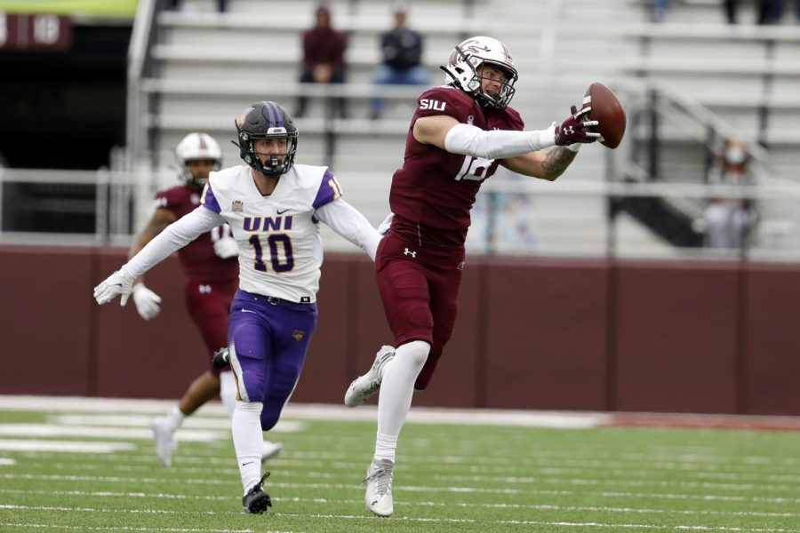 Saluki tight end Levi Mitchell gets past Panthers defender Eric Mooney to make a catch during the Saluki's 17-16 win at Saluki stadium on Saturday, March 13, 2021.