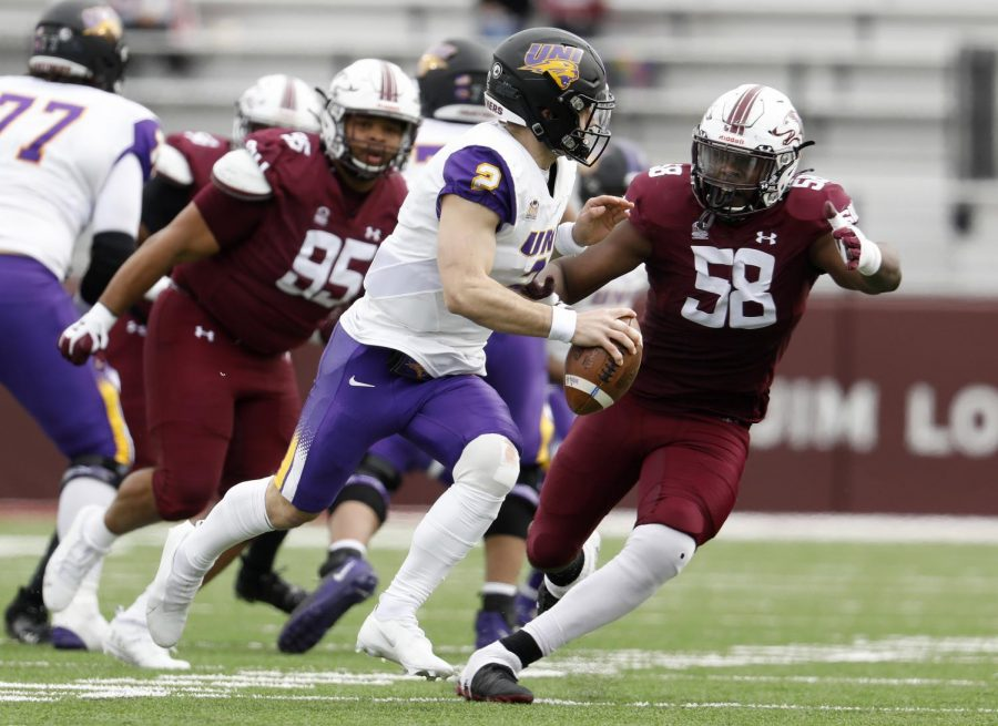 Saluki defensive end Chucky Sullivan chases Panthers QB Will McElvain during the Saluki's 17-16 win at Saluki stadium on Saturday, March 13, 2021.