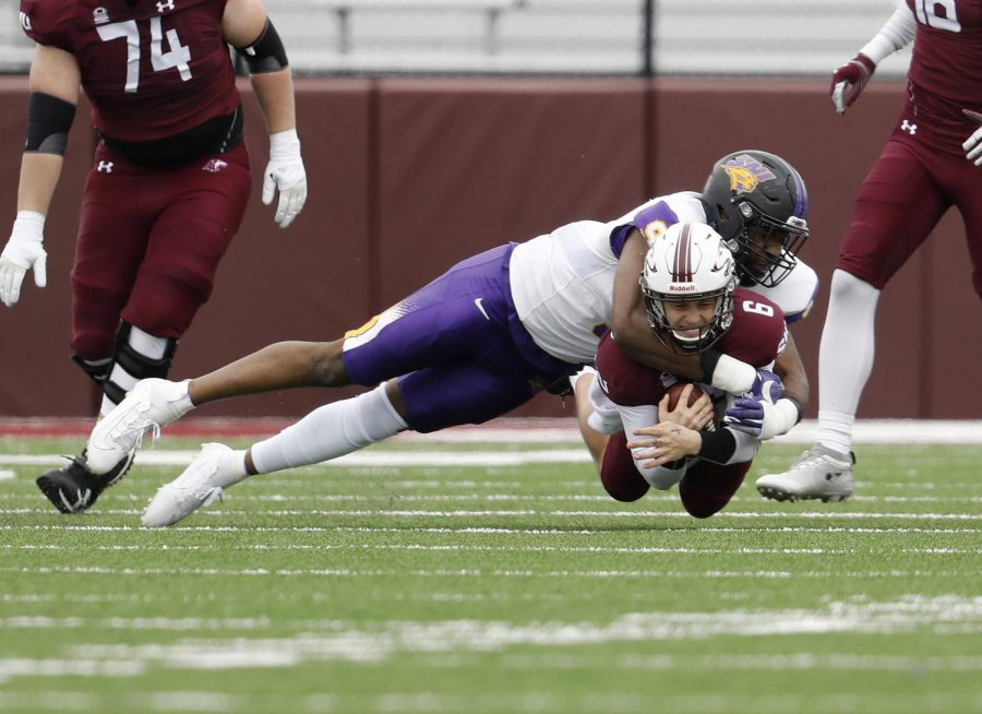 Saluki QB Stone Labanowitz braces for the impact as he's brought down by Panthers defensive lineman Brawntae Wells during the Saluki's 17-16 win on Saturday, March 13, 2021.