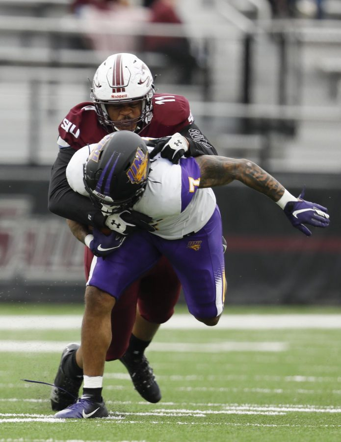 Saluki defensive end Anthony Knighton tackles Panthers running back Dom Williams during the SIU's 17-16 win at Saluki stadium on Saturday, March 13, 2021.