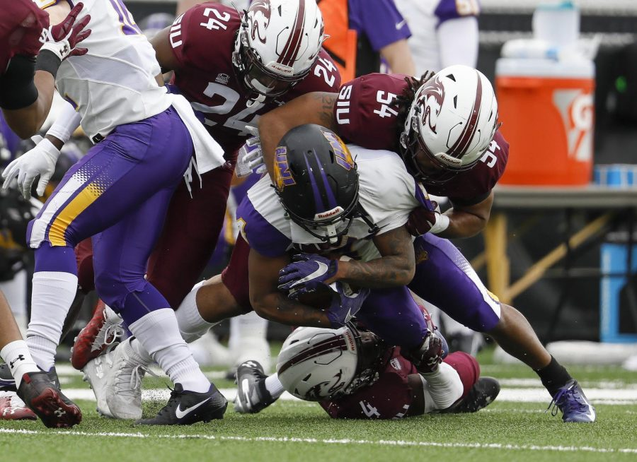 Saluki defenders Qua Brown, #24, and Bryce Notree, #54, help stop the Panthers' running game during SIU's 17-16 win over Northern Iowa University at Saluki stadium on Saturday, March 13, 2021.