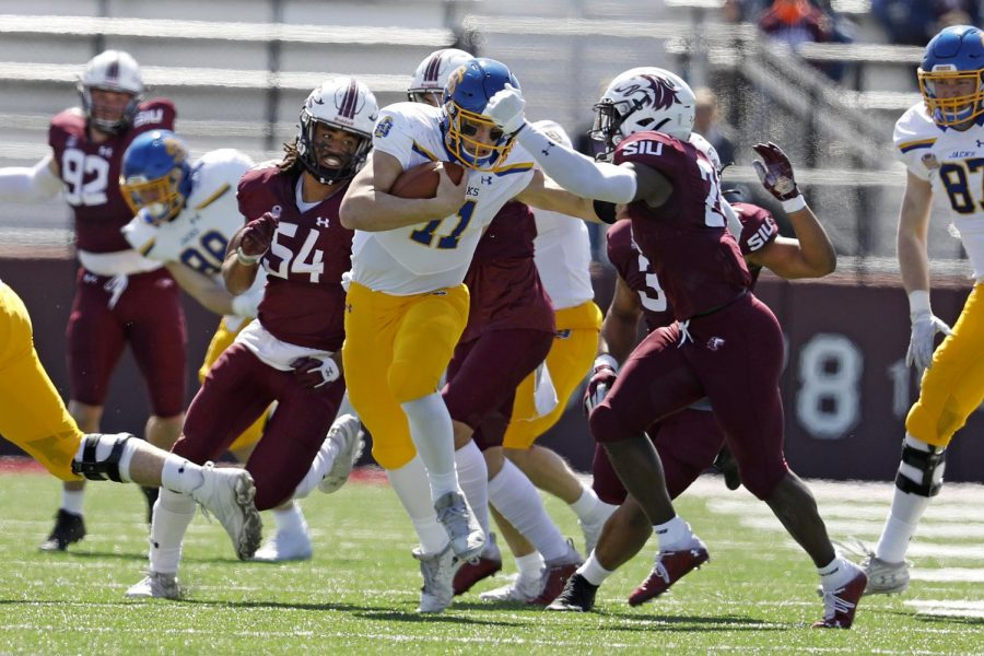 Saluki safety Qua Brown, 24, and linebacker Bryce Notree, 54, chase down the Jackrabbits' quarterback during Saturday's game at Saluki Stadium on March 20, 2021. SIU lost to South Dakota State by the score of 44-3.