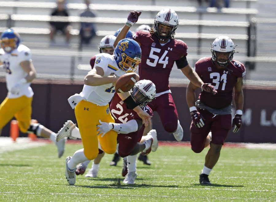 Saluki safety, Qua Brown, 24, forces the Jackrabbits' quarterback to fumble the ball, while linebackers, Bryce Notree, 54, and Bryson Strong, 31, are in hot pursuit, during Saturday's game at Saluki Stadium on March 20, 2021. SIU lost to South Dakota State by the score of 44-3.