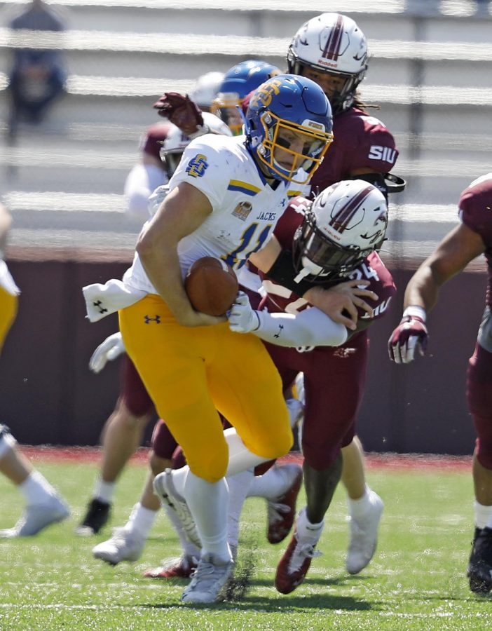 Saluki safety Qua Brown, 24, forces the Jackrabbits' quarterback to fumble the ball during Saturday's game at Saluki Stadium on March 20, 2021. SIU lost to South Dakota State by the score of 44-3.