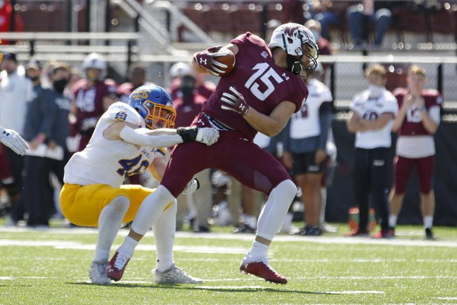Saluki running back, Javon Williams Jr., tries to break free of the Jackrabbits defenseman's grip during Saturday's game at Saluki Stadium on March 20, 2021. SIU lost to South Dakota State by the score of 44-3.