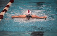 Senior, Brittany Scott, swims the women's 100-fly   on Friday, March 19, 2021.