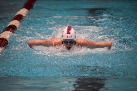 Senior, Brittany Scott, swims the women