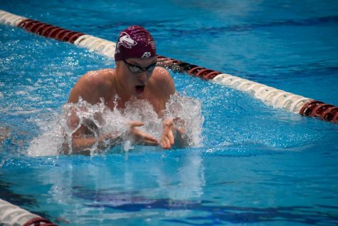 Freshman, Gustav Persson, swims the men