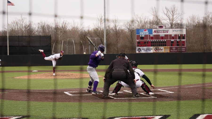 Noah Farmer (27) of Metropolis completes his pitch to catcher Austin Ulick (7) Sunday, March 14, 2021, in Carbondale, Ill.