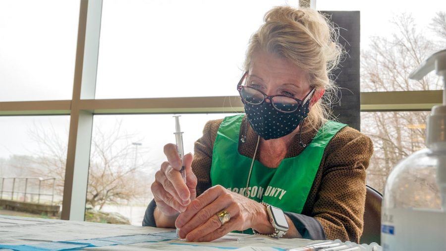 Pharmacist Pamela Hughes prepares syringes with dosages of the Moderna COVID-19 vaccine for distribution Wednesday, March 18, 2021, in Carbondale, Ill.