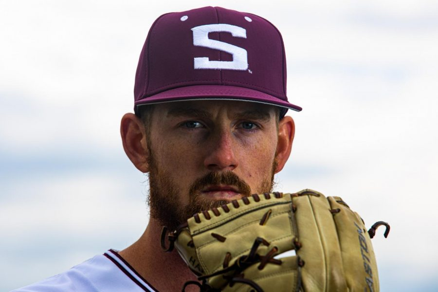 SIU pitcher, Brad Harrison, poses for a portrait in the bleachers at Itchy Jones Stadium on Wednesday, March 31, 2021 at SIU. Coming back after injuring his arm, the left-handed pitcher has been a steady arm in the Salukis' rotation. This season, Harrison threw seven innings where he struck out nine batters and two hits during a game against Marshall.