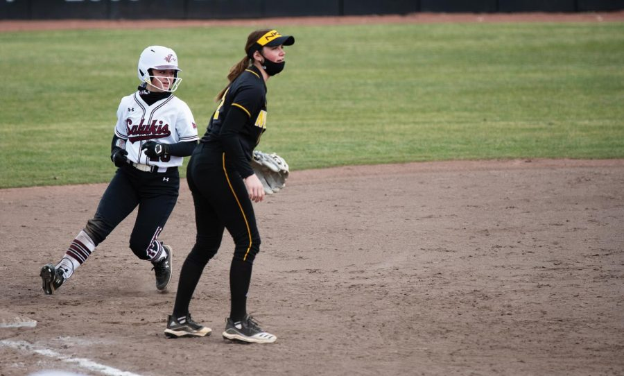 Bailey Caylor (20) makes a run during the game against Northern Kentucky University on Friday, Mar. 5, 2021 at Charlotte Softball Stadium in Carbondale, Ill.