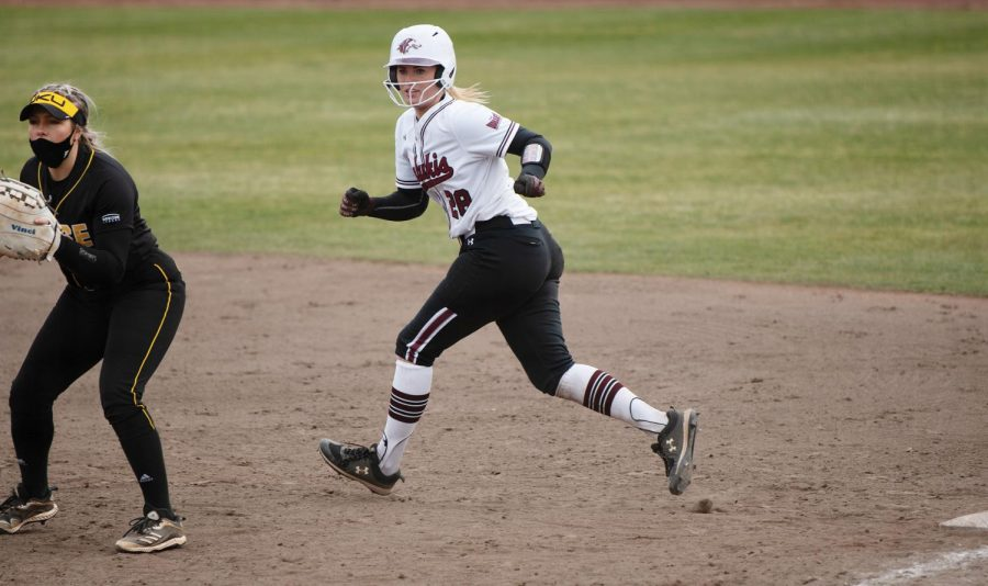 Jenny Jansen (28) makes   a run in the game against Northern Kentucky University on Friday, Mar. 5, 2021 at Charlotte Softball Stadium in Carbondale, Ill.