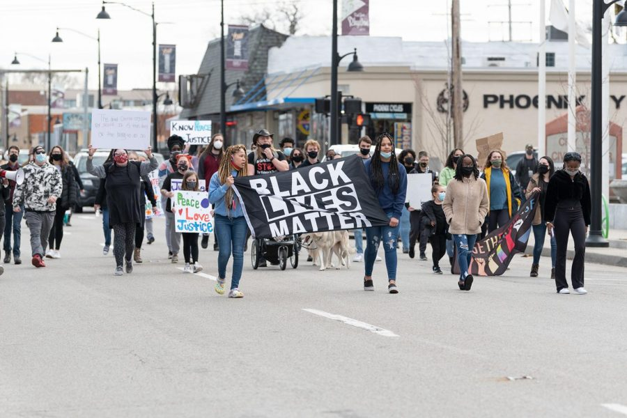 Protestors march in the road through the downtown back to Carbondale Pavilion on Saturday, March 13, 2021 in Carbondale Ill. The march ended after almost 45 mins of walking with police officers assisting in intersections.