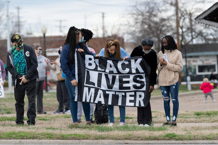 Protestors hold up a Black Lives Matter sign during the protest on the one-year anniversary of Breonna Taylor's death on Saturday, Mar. 13, 2021 at the Carbondale Pavilion in Carbondale, Ill.