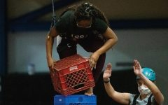Lanese Farr stacks her crate and holds her balance on Tuesday March 16, 2021, at Recreational Center, Carbondale Ill.