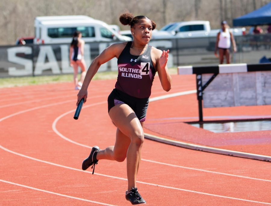 Jhordin Galmore runs in the 400-meter relay race on Saturday, March 20, 2021 at the SIU Lew Hartzog Track and Field Complex in Carbondale, Ill.