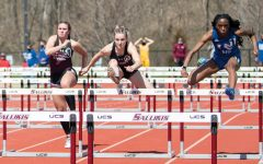 Savannah Long takes a jump in the 100-meter hurdles race on Saturday, March 20, 2021, at the SIU Lew Hartzog Track and Field Complex in Carbondale, Ill.
