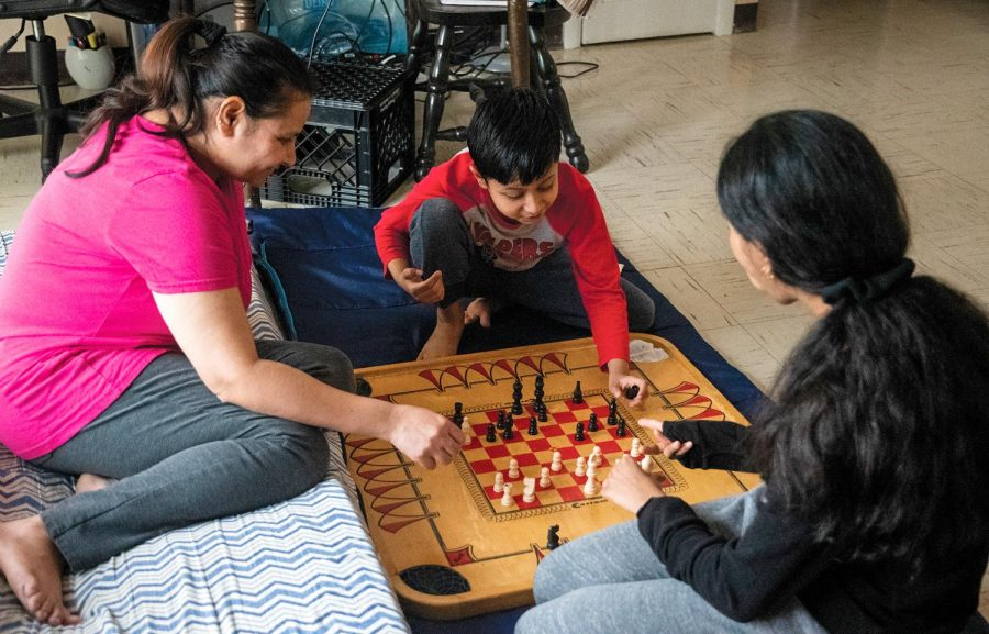 "Narmada Pandey plays chess with her kids Ayushi, 12, and Ayaan, 7, on Monday, March 22, 2021 at Evergreen Terrace Family Housing in Carbondale, Ill. ""On the other side, it's good to play with kids and spend some time with them which I missed when they were busy on their own schedule,"" Pandey said."