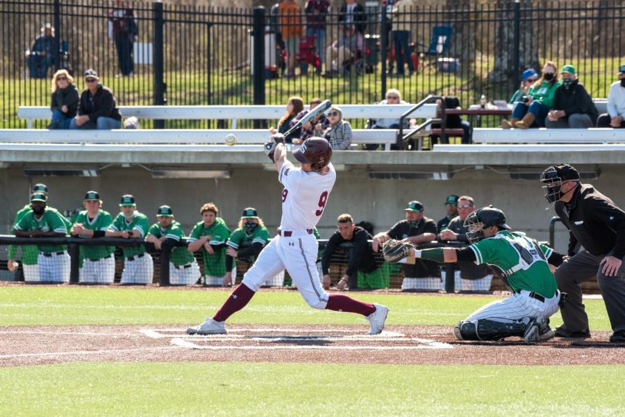 SIU infielder, Nick Neville (9), hits a pitch during the second inning against Marshall University at Itchy Jones Stadium on March 20, 2021 in Carbondale, Ill.