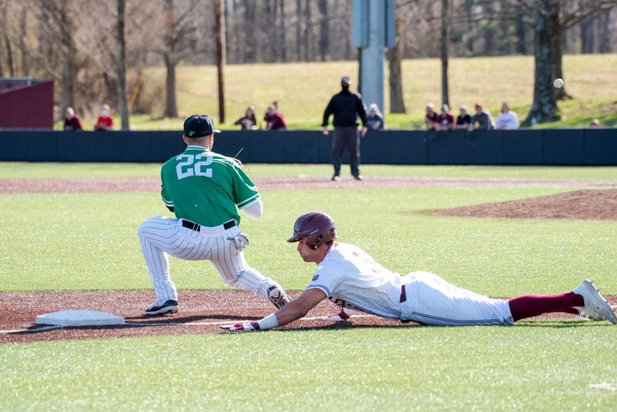 Grey Epps (5) slides back to third and is declared safe during the Saluki home game against Marshall University at Itchy Jones Stadium on March 20, 2021 in Carbondale Ill.