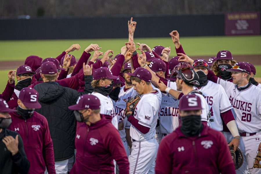 The Salukis' Baseball team huddles after the Salukis 9-1 win over Western Illinois to help extend their undefeated season to eight wins on Tuesday, Mar. 2, 2021 at Itchy Jones Stadium in Carbondale, Ill.
