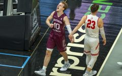 SIU guard Ben Harvey gets hyped after a foul was called on against Bradley during the Salukis' 73-63 win over the Braves on Thursday, March 4, 2021 in St. Louis at the Arch Madness Tournament.