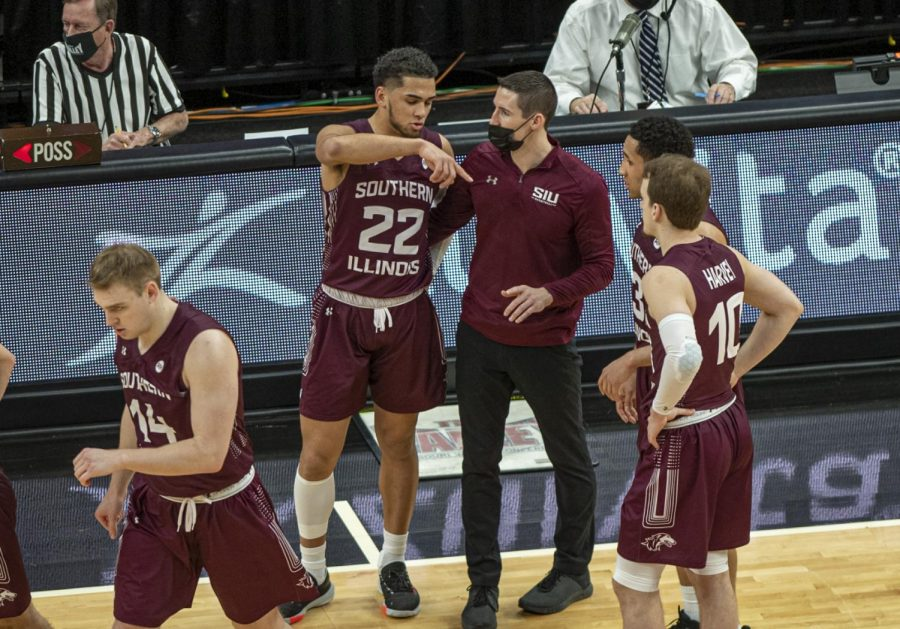 SIU guard Steven Verplancken Jr. talks to head coach Bryan Mullins as a timeout expires during the Salukis' 49-73 loss against Loyola in the Arch Madness tournament on Friday, March 5, 2021 at the Enterprise Center in St. Louis, MO.