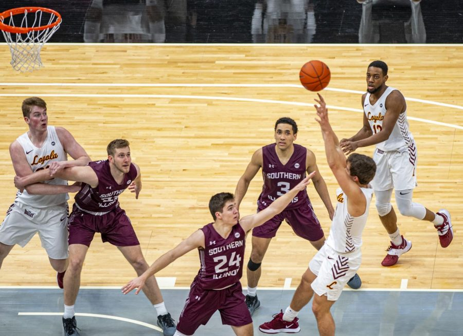 Trent Brown tries to guard a Rambler player as they shoot during the Salukis' 49-73 loss against Loyola in the Arch Madness tournament on Friday, March 5, 2021 at the Enterprise Center in St. Louis, MO.