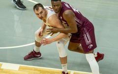 SIU forward Sekou Dembele heavily guards Cameron Krutwig of Loyola during the Salukis 49-73 loss against Loyola in the Arch Madness tournament on Friday, March 5, 2021 at the Enterprise Center in St. Louis, MO.