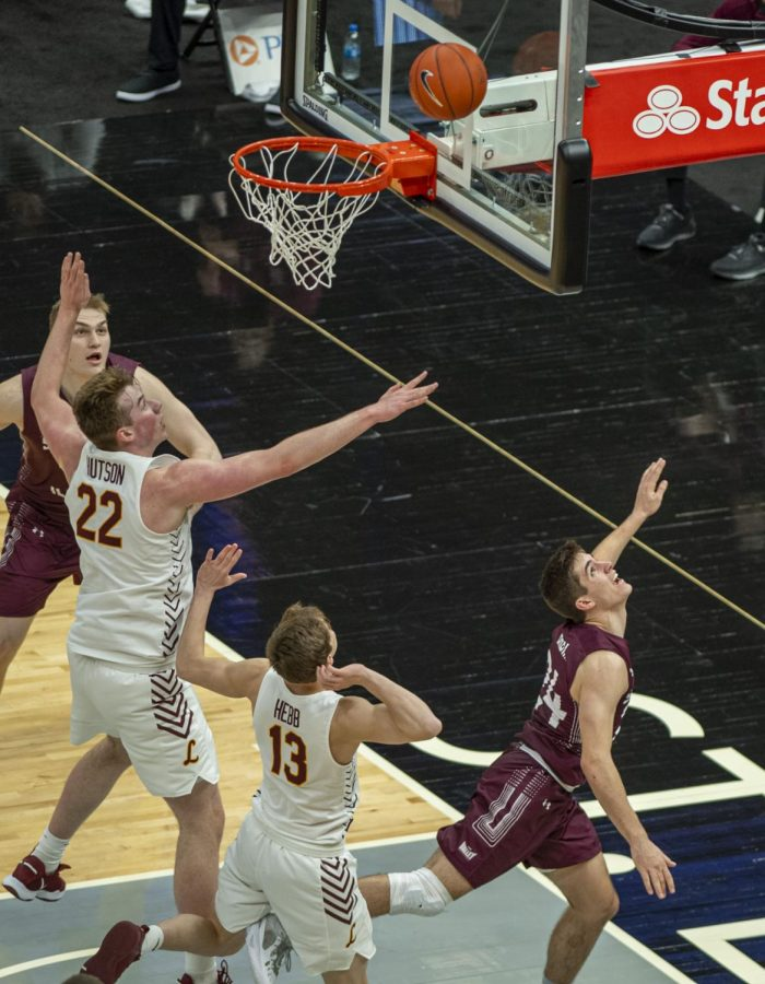 SIU guard Trent Brown looks back to see the finished product of his layup to score during the Salukis' 49-73 loss against Loyola in the Arch Madness tournament on Friday, March 5, 2021 at the Enterprise Center in St. Louis, MO.  Brown finished with four points and had four rebounds during Friday's game.