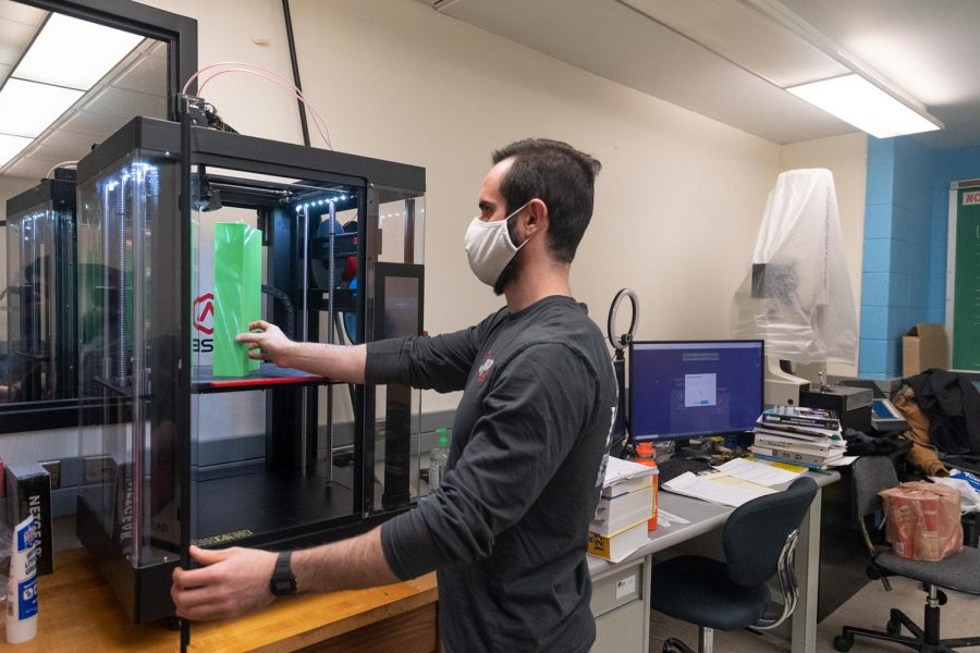 """Gustavo Felicio Perruci, a graduate student in Mechanical Engineering from Brazil, prints a sample in a 3D printer for his research in the Metrology Laboratory at Southern Illinois University in Carbondale, Ill. Perruci remembers the friend circle he had before the pandemic. """"I badly miss the International coffee hour. I had a big friend community back then,"""" Perruci said. """"I hope SIU organizes in-person activities frequently following proper guidelines so that I could feel the same again."""" Subash Kharel 