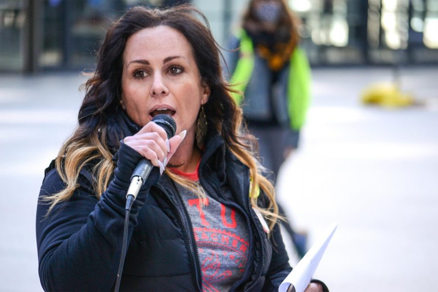 """Melissa Vozar, a member of the Chicago Teachers Union, gives a speech during a Day of Solidarity at Federal Plaza in Chicago, Ill. on March 20, 2021. """"Just like the spark that CTU ignited in 2012 that set off the start of teacher strikes across the US, a win and Alabama can set the stage for Amazon workers to unionize throughout this country,"""" Vozar said."""