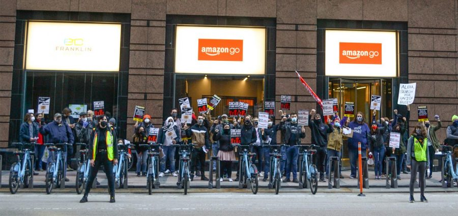 Supporters of a unionization effort at an Amazon warehouse in Alabama pose outside of an Amazon Go store during a Day of Solidarity on March 20, 2021 in downtown Chicago,Ill.