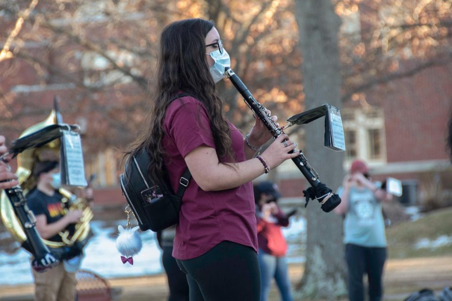 Ariana Fuller-Moutell, a senior majoring in music, plays the clarinet outside Shryock Auditorium on Feb. 22, 2021 Carbondale Ill.