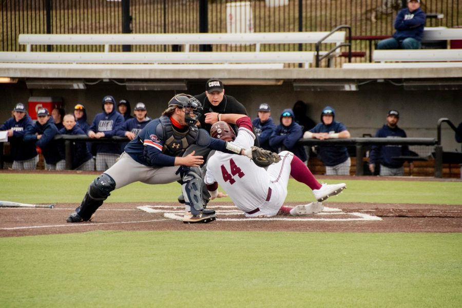 Salukis' Phillip Archer slides into home plate during the Salukis home game against Tennessee  Martin on Friday Mar. 5 2021 at Itchy Jones Stadium in Carbondale, Ill.